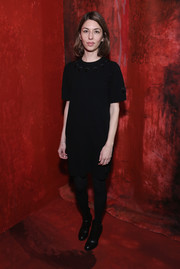 Sofia Coppola opted for black ankle boots to pair with her dress.