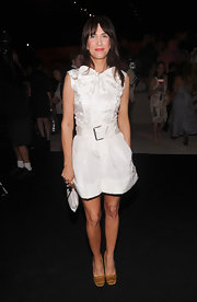 Kristen Wiig added a pop of color to her white wears with these rich yellow buckle-embellished flats.