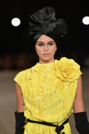 Kaia Gerber was all about vintage glamour wearing this black satin head wrap and yellow sequin dress combo on the Marc Jacobs runway.