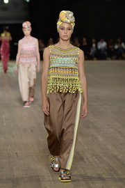 Adwoa Aboah cut an exotic figure in this multicolored beaded top on the Marc Jacobs runway.