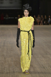 Kaia Gerber cut a chic figure in a yellow sequin gown with oversized flower detail while walking the Marc Jacobs runway.