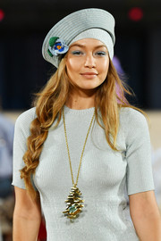 Gigi Hadid glammed up her casual look with an oversized pendant necklace for the Marc Jacobs Spring 2020 show.