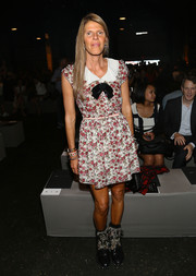 Anna dello Russo played with contrasts, teaming her floral dress with edgy studded black boots by Saint Laurent.