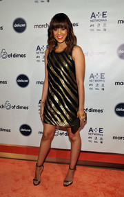 Tia Mowry kept the shimmer going via a pair of gold ankle-strap sandals.