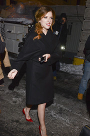 Anna Kendrick was all covered up in a classic black wool coat as she arrived for the Marchesa fashion show.