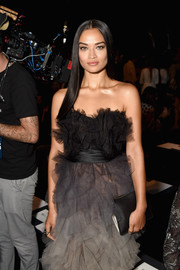 Shanina Shaik paired a simple black leather clutch with a layered tulle dress for the Marchesa fashion show.