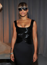 Eve looked subdued yet elegant with this LBD and wayfarers combo at the Marchesa fashion show.