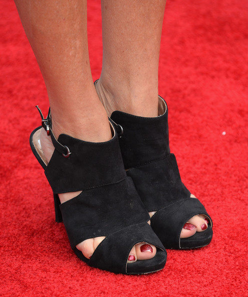 Marcia Gay Harden Cutout Boots [cloudy with a chance of meatballs 2,footwear,shoe,sandal,leg,high heels,human leg,ankle,red,foot,toe,marcia gay harden,shoe detail,regency village theatre,california,columbia pictures,sony pictures animation,red carpet,premiere,premiere]