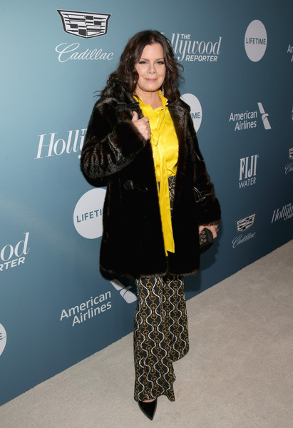 Marcia Gay Harden Fur Coat [hollywood reporter,clothing,yellow,outerwear,fashion,fur,carpet,premiere,footwear,flooring,event,power 100 women in entertainment - red carpet,power 100 women in entertainment,marcia gay harden,california,los angeles,milk studios]