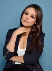 Mila Kunis wore her hair loose in a subtly wavy style at the TIFF portrait studio.