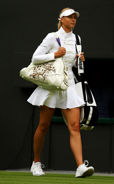 Maria Sharapova Sun Visor [day one,singles,tennis,tennis player,sport venue,championship,lady,competition event,individual sports,fashion,racquet sport,racket,women,maria sharapova,wimbledon,court,russia,ukraine,championship,match]