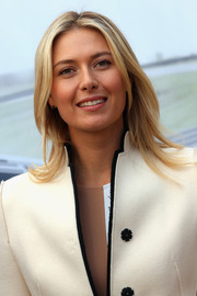 Maria Sharapova wore her hair in soft shoulder-length layers during the presentation of her personalized Porsche Panamera GTS.