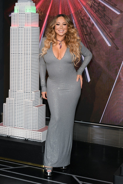 Mariah Carey dazzled in a form-fitting gray gown while lighting the Empire State Building.