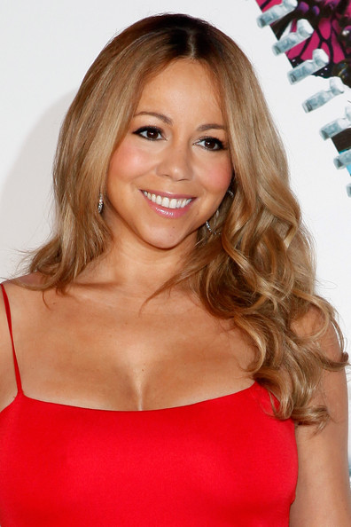 Mariah Carey wore her long golden locks in soft spiral curls at a press conference announcing her as the new Jenny Craig Brand Ambassador.