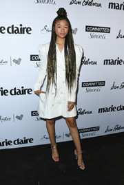 Storm Reid styled her dress with a pair of multicolored strappy sandals by Cushnie et Ochs.