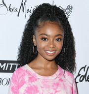 Skai Jackson looked cute wearing this partially braided, curly ponytail at the 2018 Marie Claire Fresh Faces event.