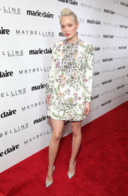 Pom Klementieff paired her lovely dress with embellished silver pumps by Christian Louboutin.