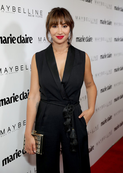 Jackie Cruz paired a patterned box clutch with a black jumpsuit for the Marie Claire Fresh Faces celebration.