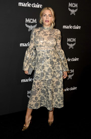 Busy Philipps cut a stylish figure in a tiered, sequined midi dress by Cynthia Rowley at the Marie Claire Change Makers celebration.