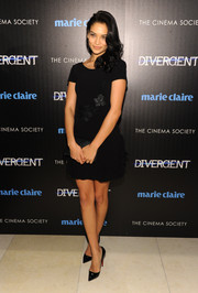 Shanina Shaik went the girly route in a little black dress with floral embroidery and ruffle detailing during the 'Divergent' screening in NYC.