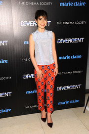 Sami Gayle finished off her outfit in vibrant style with a pair of orange print pants.