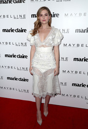 Zoey Deutch matched her blouse with a knee-length, lace-panel skirt.