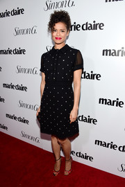 Gugu Mbatha-Raw looked simply lovely in a star-embellished black shirtdress by Coach at the Marie Claire Fresh Faces party.