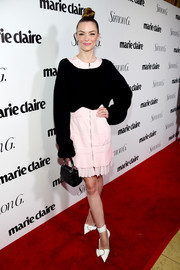Jaime King went for a layered look with this black boatneck sweater and pink zip-front dress combo (both by Dior) at the Marie Claire Fresh Faces party.