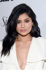Kylie Jenner attended the Marie Claire Fresh Faces party wearing this loose wavy 'do.