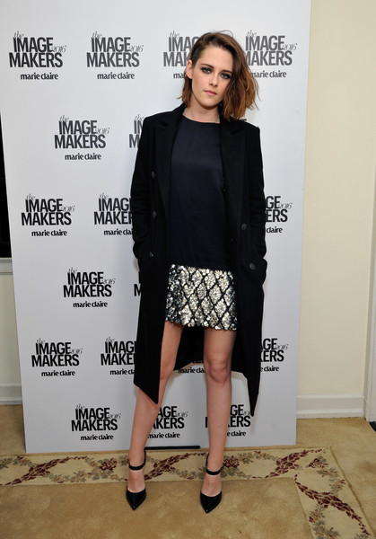 Kristen Stewart layered a black Rag & Bone coat over a sequined mini dress for the 2016 Marie Claire Image Maker Awards.