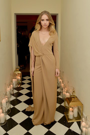 Suki Waterhouse attended Marie Claire's Image Maker Awards in a nude draped, wrape dress with a plunging V-neck.