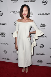 Chriselle Lim gave off an elegant feel with her white off-the-shoulder dress that featured ruffled sleeves.