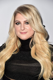 Meghan Trainor styled her long blonde locks in a wavy, textured cut to frame the singer's face.