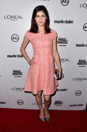 Alexandra Daddario looked flirty and sophisticated in a soft pink tweed above-the-knee dress.