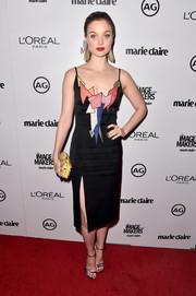 Bella Heathcote wore an eclectic black midi dress wit ha thigh-high slit and geometric designs to Marie Claire's Image Maker Awards.