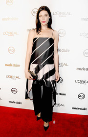 Jessica Pare teamed her dress with black wide-leg pants.