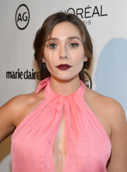 For her lips, Elizabeth Olsen chose a glossy berry hue.
