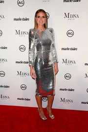 Heidi Klum brought major shine to the 2018 Image Makers Awards with this silver sequin dress by Alex Perry.