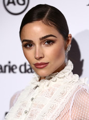 Olivia Culpo looked simply elegant wearing this side-parted chignon at the 2018 Image Makers Awards.