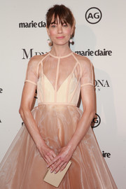 Michelle Monaghan went for a monochromatic palette with this box clutch and dress combo at the 2018 Image Makers Awards.