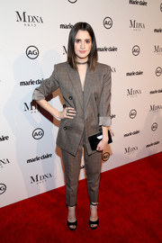 Laura Marano opted for a business-chic look with this patterned pantsuit by Camilla and Marc at the 2018 Image Makers Awards.