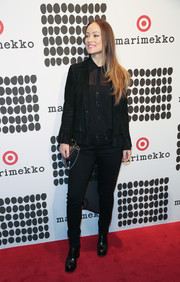 Olivia Wilde completed her all-black outfit with a pair of platform ankle boots.
