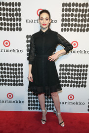 Emmy Rossum was classic and stylish in a perforated black shirtdress while attending the Marimekko for Target launch.