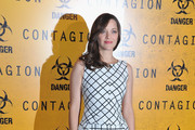 Marion Cotillard's Feathered Flip at the Paris Premiere of 'Contagion'