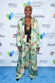 Cynthia Erivo suited up boudoir style in this floral silk coat and pants combo for the Joyful Revolution Gala.