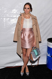 Louise Roe attended the Marissa Webb fashion show wearing a classic beige coat over a blouse-mini skirt combo.