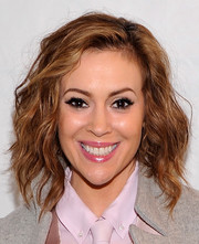 Alyssa Milano wore her hair in edgy shoulder-length waves during the Marissa Webb fashion show.