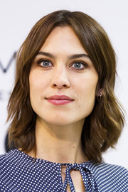 Alexa Chung looked youthful with her short, center-parted waves during the launch of her collaboration with Marks & Spencer.