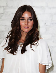 Olivia Palermo paired her white blouse with long brunette curls.