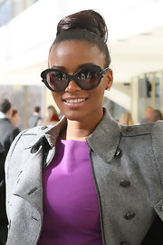 Leila Lopes attended the Marlon Gobel fall 2012 fashion show wearing her hair in a voluminous loose bun.